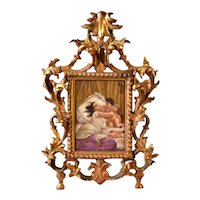Miniature painting of porcelain of a woman with cherub or cupid in gilt frame