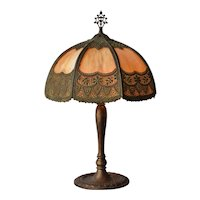 Bradley and Hubbard lamp with lattice work metal over curved caramel glass