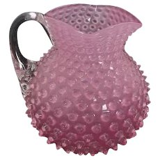 Bulbous glass Victorian hobnail cranberry pitcher