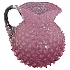 Bulbous glass Victorian hobnail cranberry pitcher
