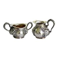Art Nouveau sterling silver sugar and creamer with floral repousse