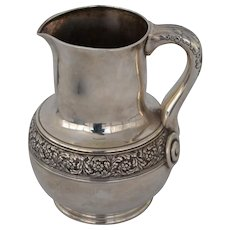 Tiffany Sterling silver pitcher with  embossed design
