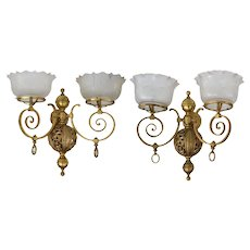 Matched pair of brass Victorian wall gas sconces with double arms and etched shades