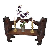Black Forest bear bench with a bear on each side and two oak leaves in the middle