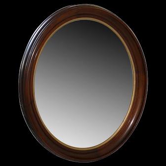 Large oval walnut Victorian mirror