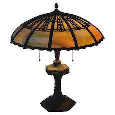 Slag glass lamp attributed to Bradley and Hubbard
