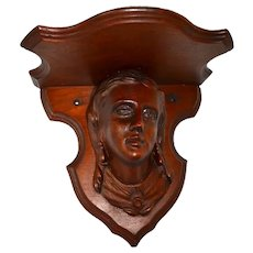 Carved bust Victorian walnut shelf with woman