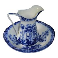 Flow blue chamber or pitcher and bowl set in Tuscan pattern made by Myotts