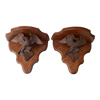 Pair of Victorian walnut eagle shelves made by John Haley Bellamy.