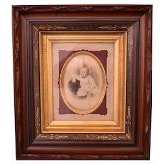 Deep Victorian walnut frame with photograph