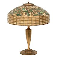 "18"" leaded glass signed ""Tiffany Studios 585"" table lamp"