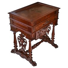 Victorian walnut sewing stand with finished interior, carved pull out drawer and claw feet