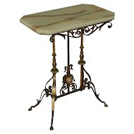 Brass and iron stand with original onyx top and hoof feet