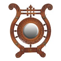 Oak chip carved round beveled wall mirror with four hat hooks