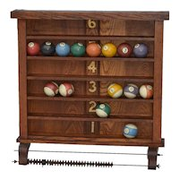 Oak pool or billiard ball hold with a full set of original pool balls - attributed to Brunswick Balke Collender Company
