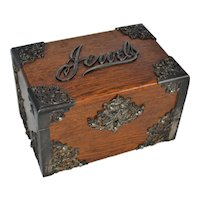 Oak jewelry box with metal decoration