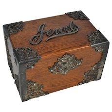 Oak jewelry box with metal decoration