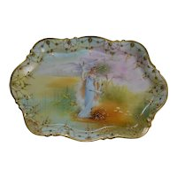 Nippon pin tray depicting an elegant woman on edge of lake
