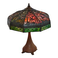 Signed Handel #5066 sunset palm overlay table lamp with nine sides