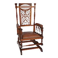 Fancy oak platform rocker with open carved fretwork back