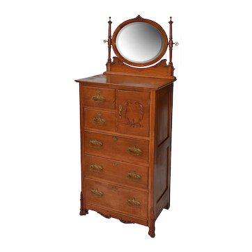 Quartered oak lingerie chest with a hatbox or bonnet compartment