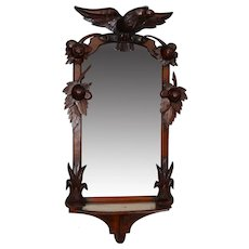 Walnut Victorian eagle and fruit carved wall mirror