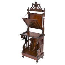 Renaissance Revival walnut Victorian upright music stand with burl, ebonized, gilt and incised carved decoration.