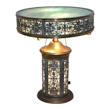 Unusual slag glass lamp with silver plated metal frame and blue slag panels