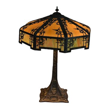 Empire Lamp Company slag glass lamp with silver plated frame featuring swans and flowers.