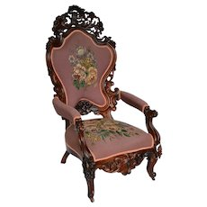 Rococo Victorian open carved rosewood armchair with needlepoint upholstery