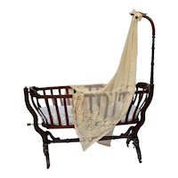 Walnut Rococo Victorian child's crib featuring a carved birds head and original valance