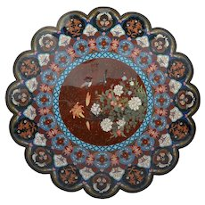 Large cloisonne charger with birds and flowers on a rust colored background