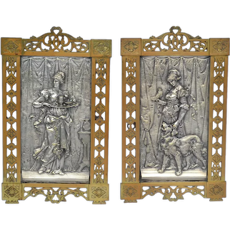 Art Nouveau bronze wall plaques with silver plated raised inserts