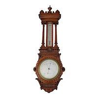 English oak barometer made by Dollond London