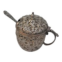 Sterling repousse silver sugar or sauce pot made made by Hennigan.Bates & Co with spoon