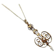 Antique Edwardian 10K gold diamond and seed pearl halo long drop lavalier pendant necklace