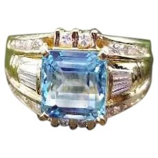 Modern estate European made 18k gold 2.77 carat aquamarine with channel set .75 ct baguette and round diamond ring, size 7-3/4