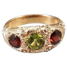 Antique Edwardian 10k gold heavily chased garnet and peridot three stone ring, size 7