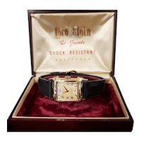 Vintage mid century 14k gold filled Lord Elgin Edgewater screwback tank style wrist watch circa early 1950s, complete with original box