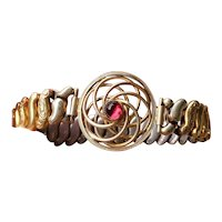 Vintage gold filled stretch expansion sweetheart bracelet unusual spiral with red glass paste cabochon signed Co-Star, W & H Jewelry Co.