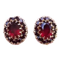 Modern estate 14k gold pierced garnet halo earrings