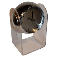 Mid Century Modern Space Age Chrome Acrylic Eyeball Clock by Robert Sonneman.