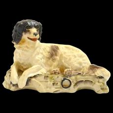 Victorian Bisque Reclining Dog Figurine