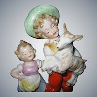 Early, German Hand-Painted Porcelain Figurine, Young children with baby Goat, circa 1920-1930