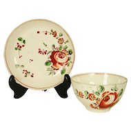 Creamware Tea Bowl and Saucer in King's Rose Decoration, 1770-1780