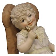 Child In A Chair - Vintage Figurine