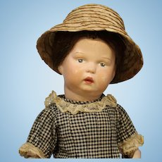 Darling Antique Schoenhut Wood Doll in Black Check Dress