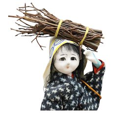 Very Cute Asian Doll Carrying Firewood