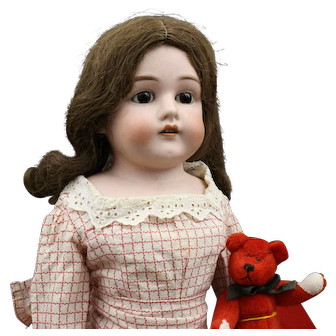 Antique German Bisque Doll with Red Teddy Bear