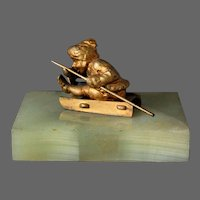Art Deco Statue of Boy on Sled  Paper Weight
